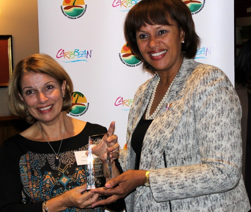 Travelbunny accepts her award at the Caribbean Tourism Organisation Journalism Awards in 2016
